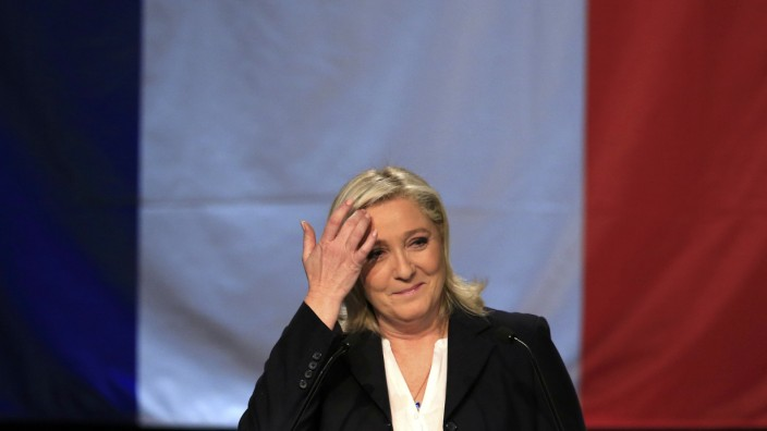 French National Front political party leader and candidate Marine Le Pen reacts as she delivers her speech after the announcement of the results during the first round of the regional elections in Henin-Beaumont