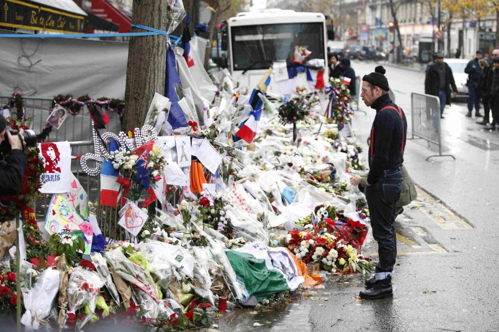 Jesse Hughes, member of Eagles of Death Metal band, mourns in front of the Bataclan concert hall to pay tribute to the shooting victims in Paris