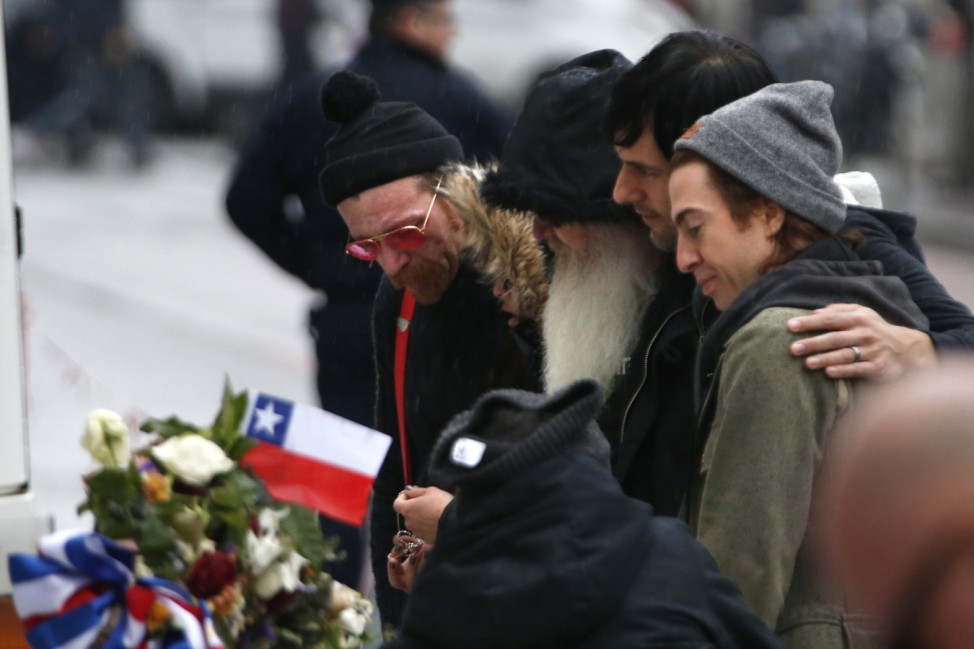 Jesse Hughes, Dave Catching, Matt McJunkins and Julian Dorio, members of Eagles of Death Metal band, mourn in front of the Bataclan concert hall to pay tribute to the shooting victims in Paris