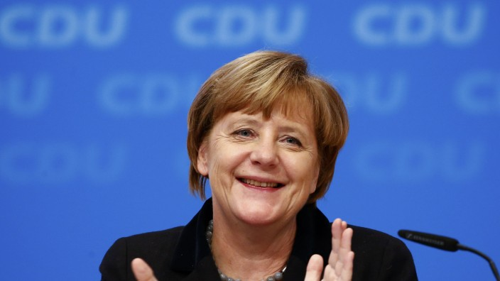 German Chancellor and leader of the CDU Merkel applauds after the overwhelming vote on a declaration about refugees during the CDU party congress in Karlsruhe