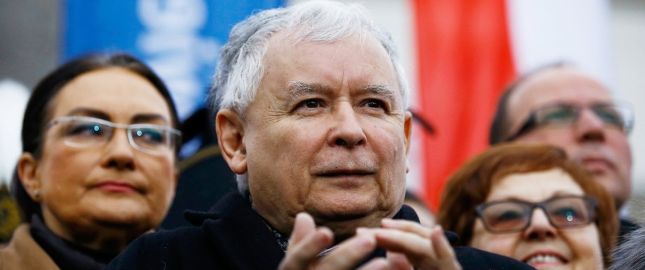 Kaczynski, leader of ruling Law and Justice party applauds during pro-government demonstration in Warsaw