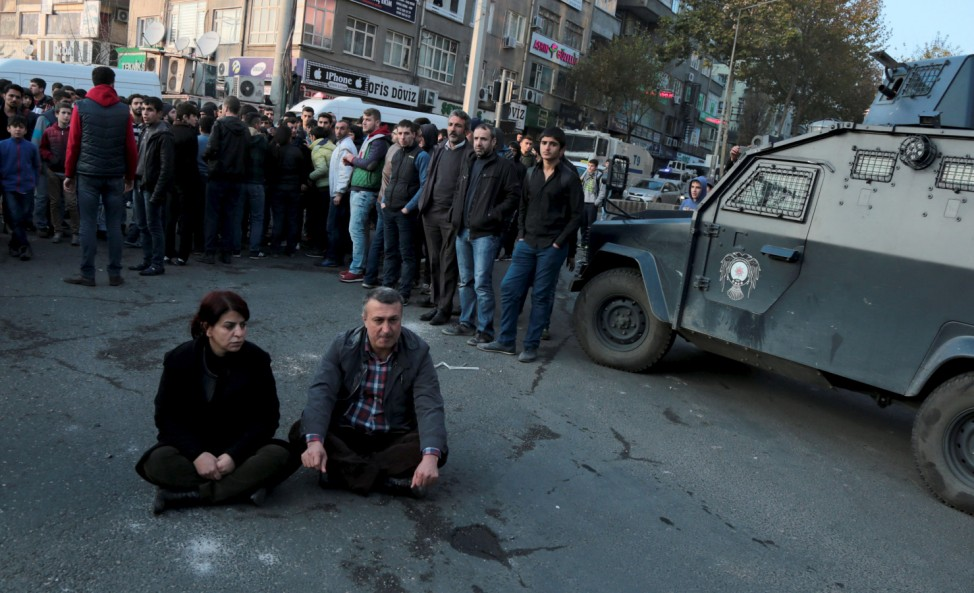 Sibel Yigitalp, a parliamentarian from the the pro-Kurdish Peoples' Democratic Party (HDP), and Abdullah Akengin, a former local mayor, holds a sit-in protest against the curfew in Sur district, in the southeastern city of Diyarbakir, Turkey,