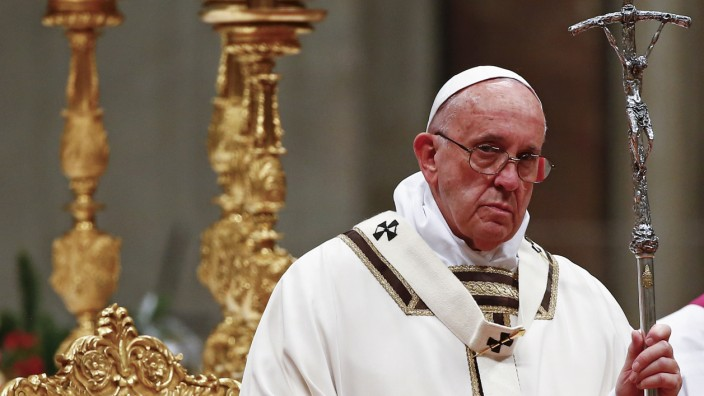 Pope Francis leads the Christmas night mass in Saint Peter's Basilica at the Vatican