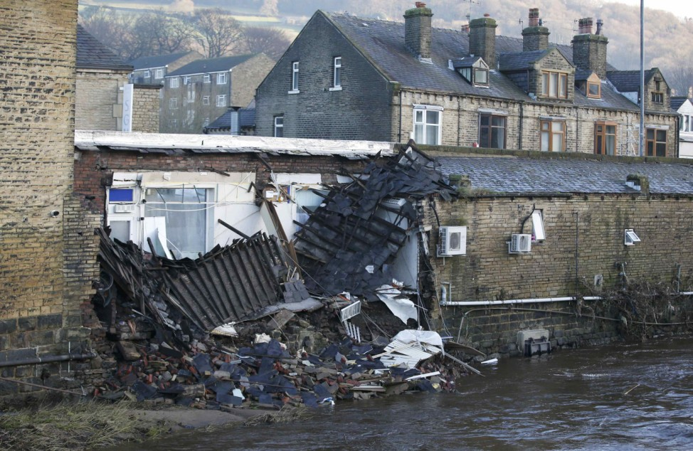 A building that collapsed during flooding is seen in the town of Mytholmroyd, northern England