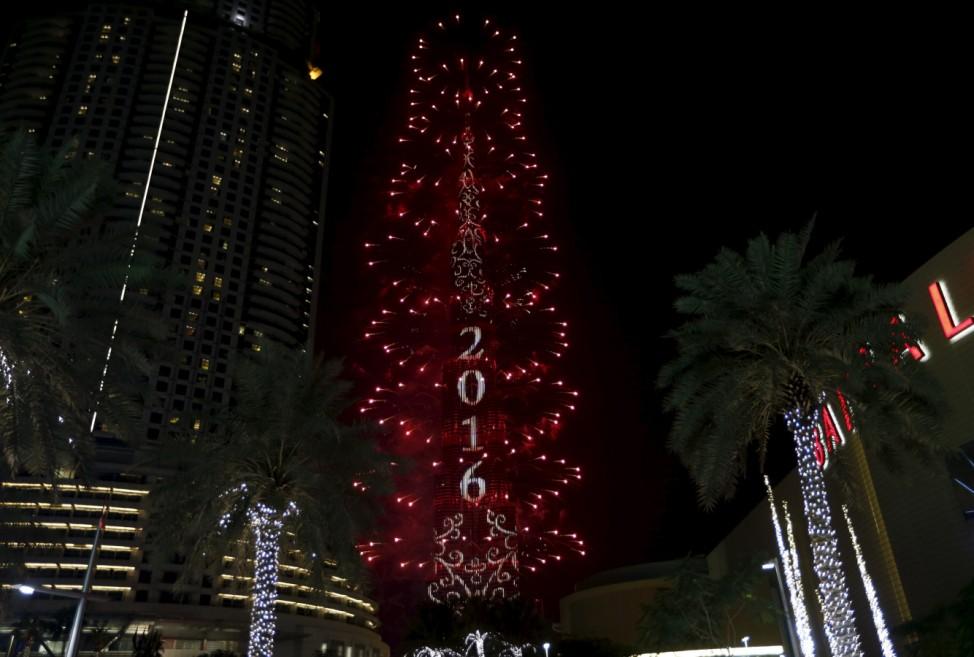 Fireworks explode over Dubai's Burj Khalifa, the tallest building in the world, during New Year celebrations