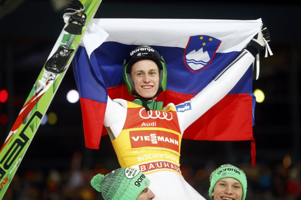 Prevc of Slovenia is carried on the shoulders of his Slovenian team mates after he won the overall ranking of the 64th four-hills Ski jumping tournament in Bischofshofen
