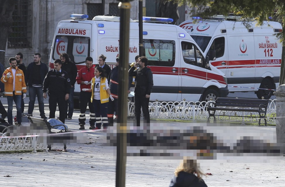 Rescue teams gather at the scene after an explosion in central Istanbul