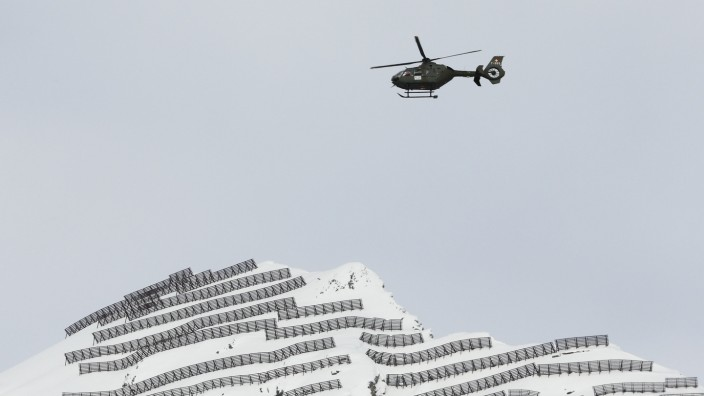 Swiss Army helicopter flies over the area ahead of the Annual Meeting 2016 of the World Economic Forum in Davos