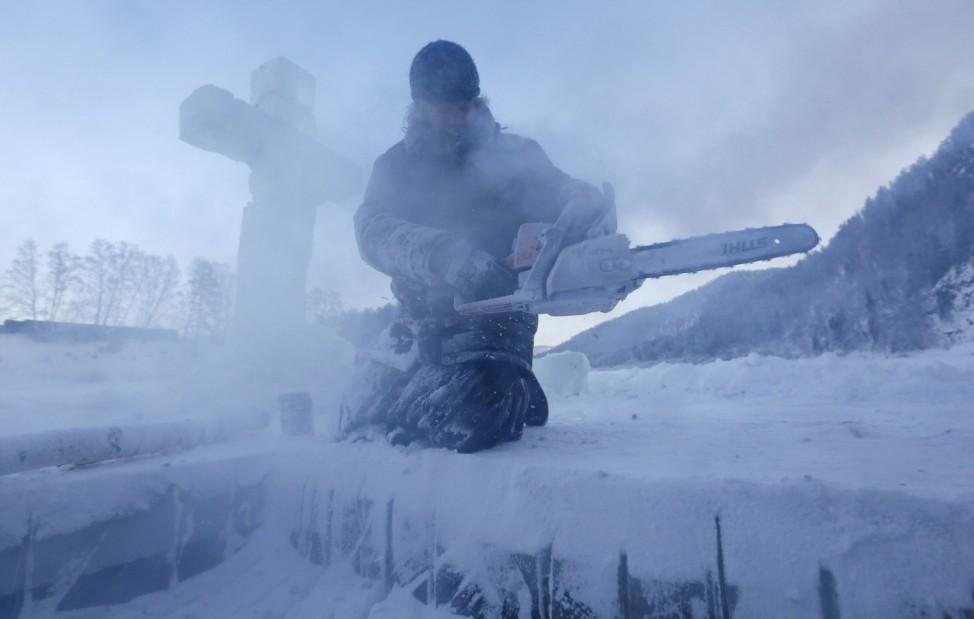 Hieromonch prepares ice hole for Orthodox Epiphany ceremony in Krasnoyarsk