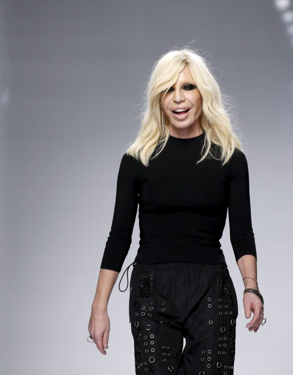 Italian designer Donatella Versace appears at the end of her Haute Couture Fall/Winter 2016/2017 fashion show for Atelier Versace in Paris