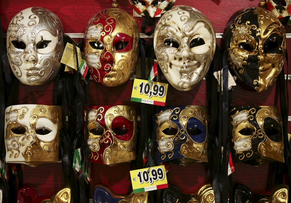 Carnival masks hang on the wall of the shop near St. Mark's Square during the Venice Carnival