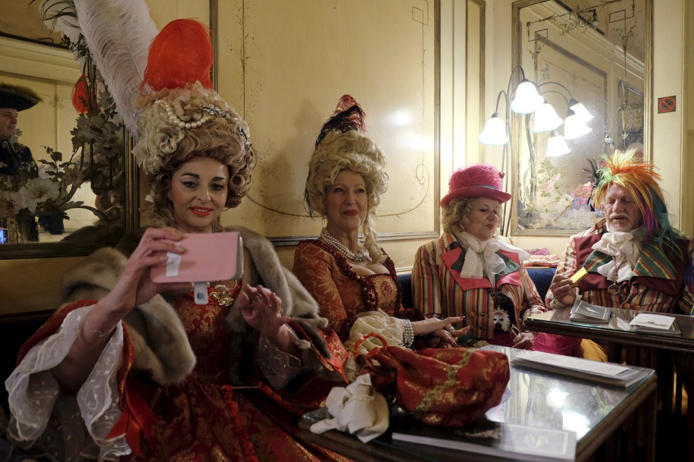Revellers seen in at the Caffe Florian coffee shop in Saint Mark's Square during the Venice Carnival, Italy