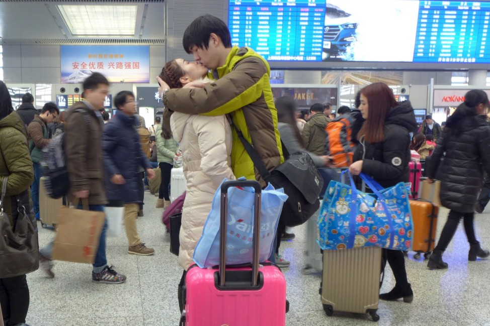 A couple kisses at Shanghai Hongqiao Railway Station ahead of the upcoming Chinese Lunar New Year
