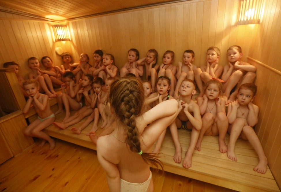 Children warm themselves in sauna before going outside and pouring cold water on themselves at local kindergarten in Krasnoyarsk