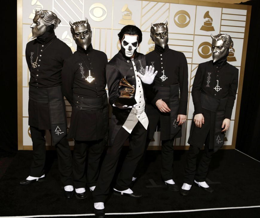 Ghost poses with their award during the 58th Grammy Awards in Los Angeles