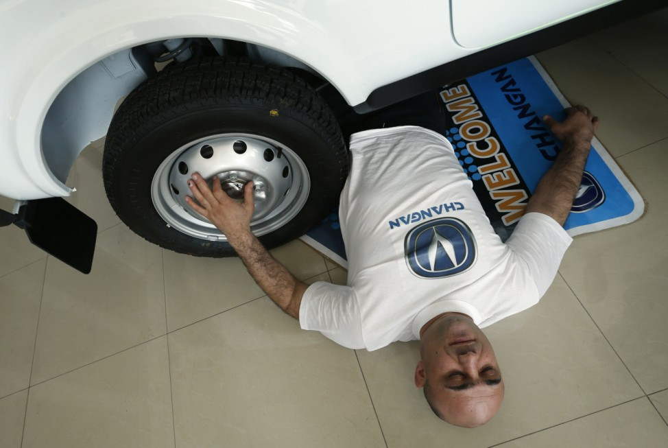 Yajian rests after a four wheel car drove over him during his attempt to break a Guinness record in Tbilisi