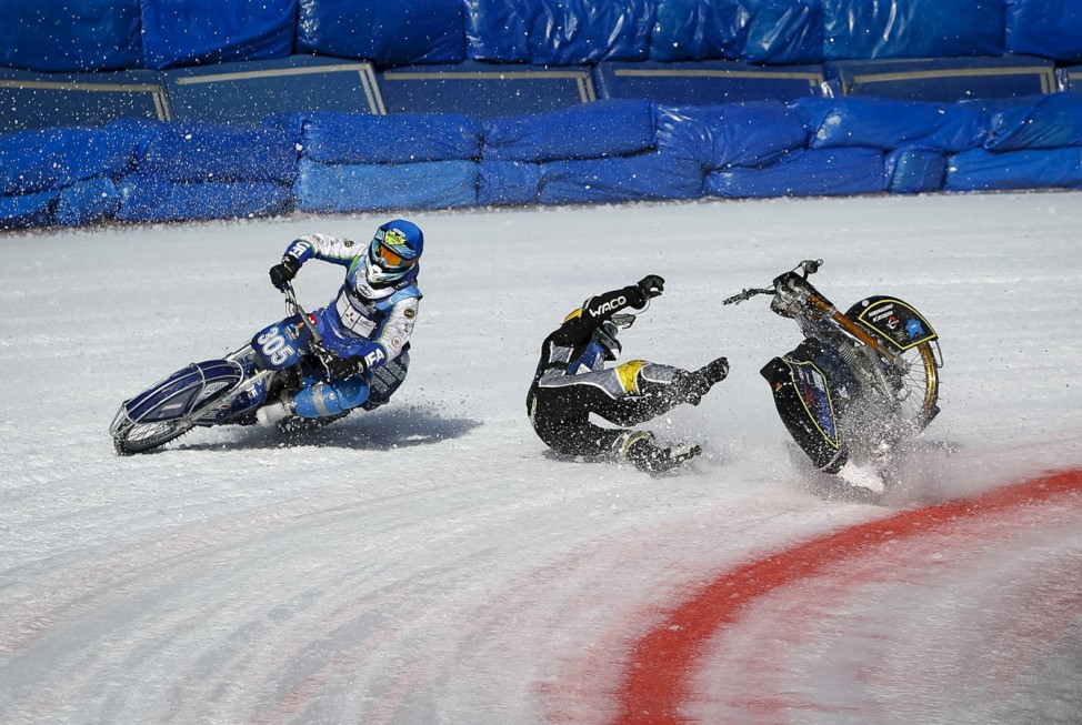 Ledstrom of Sweden crashes next to Myshkovets of Russia during FIM Ice Speedway Gladiators World Championships at the Medeo rink in Almaty