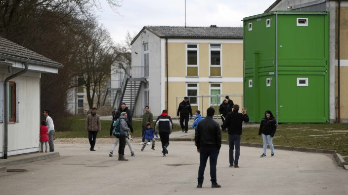 Migrants are pictured in refugee deportation registry centre in Manching