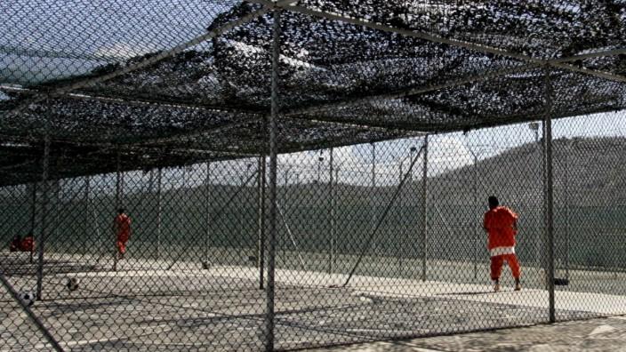 File photo of detainees at Camp Delta at the U.S. Naval Base Guantanamo Bay, Cuba exercising in Camp 3