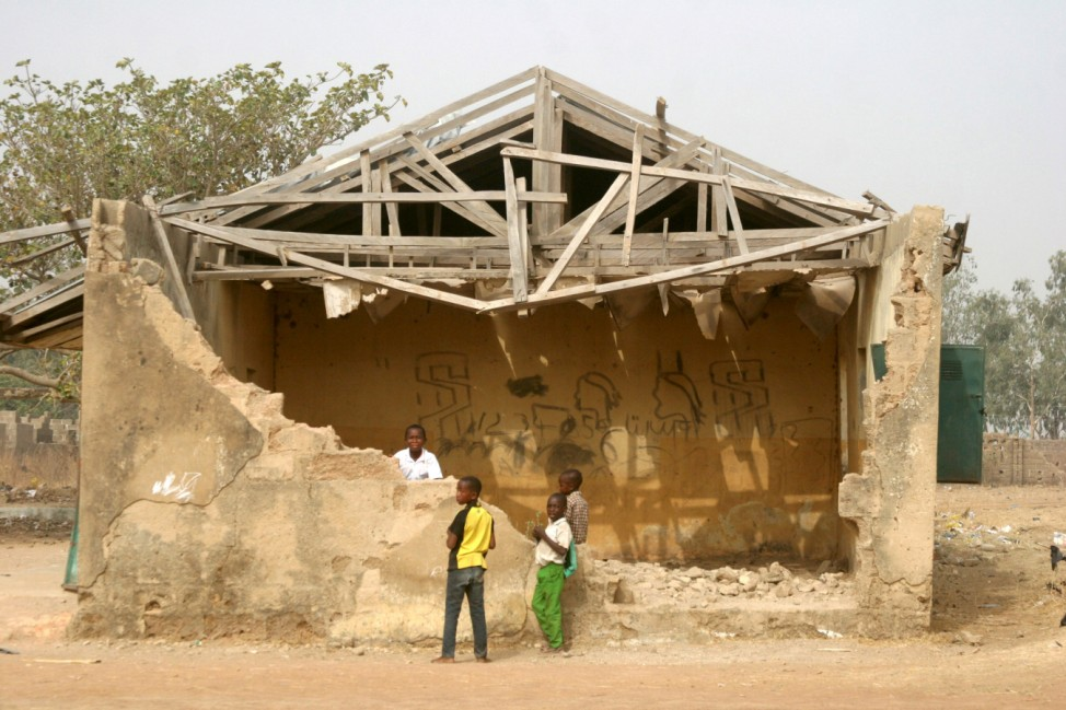 Schoolchildren stand near a dilapidated building of their primary school in Igabi local government area in Kaduna