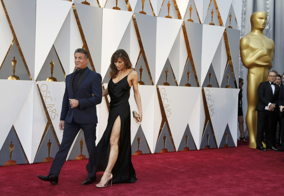 Sylvester Stallone, nominated for Best Supporting Actor for his role in 'Creed,' and wife Jennifer Flavin arrive at the 88th Academy Awards in Hollywood