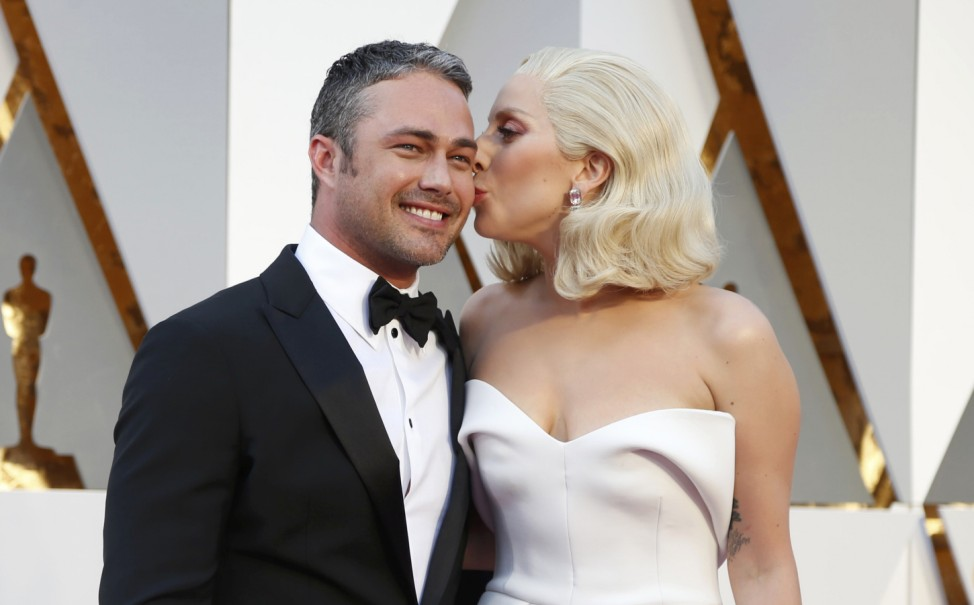Presenter Gaga arrives with boyfriend Kinney at the 88th Academy Awards in Hollywood