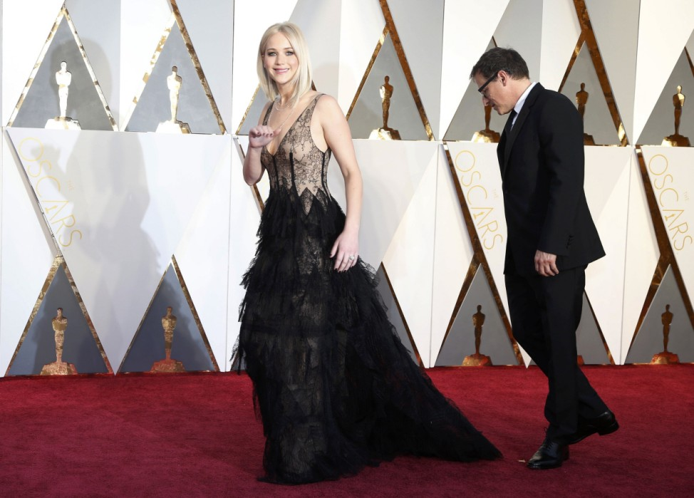 Jennifer Lawrence, nominated for Best Actress for her role in 'Joy,' arrives at the 88th Academy Awards in Hollywood