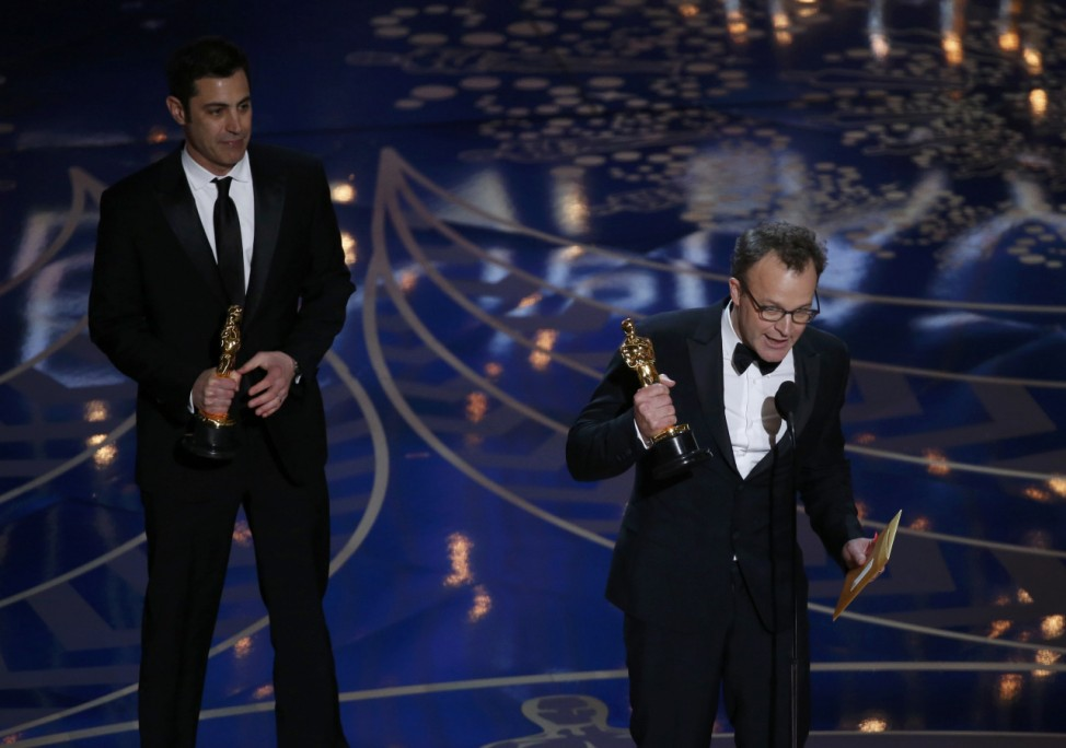 Director McCarthy and Singer accept the award for Best Original Screenplay for their film 'Spotlight' at the 88th Academy Awards in Hollywood