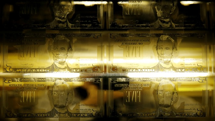 Engraving printing plates of former US President Abraham Lincoln on the five-dollar bill currency are seen on printing press at Bureau of Engraving and Printing in Washington