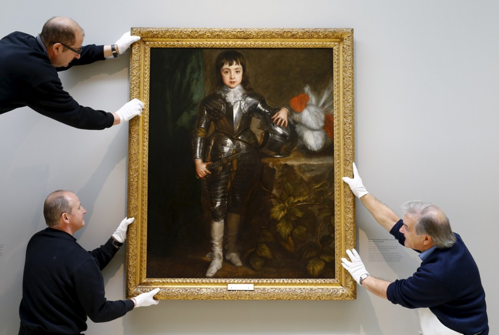 Curator Stuart Baker, Gallery Assistants Ian Evans and David Wells hang a picture of Charles II as Prince of Wales from 1638 by Anthony van Dyck in the Portland collection at the Hartley Gallery near Worksop