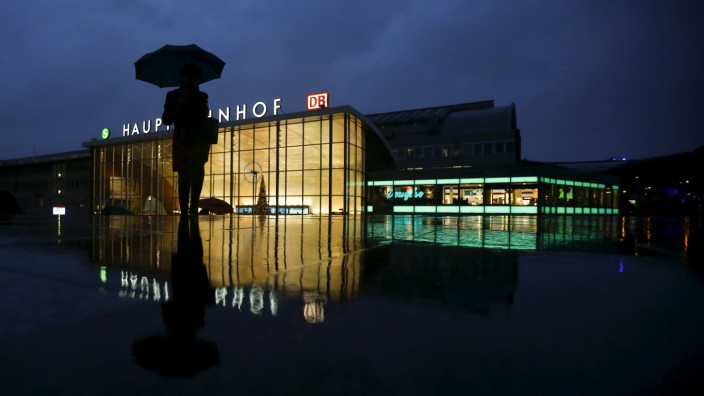 A woman walks in front of the main railway station in Cologne
