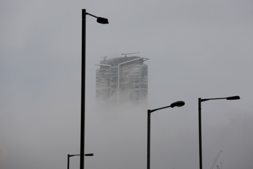 A high-rise residential apartment is seen under foggy weather in Hong Kong