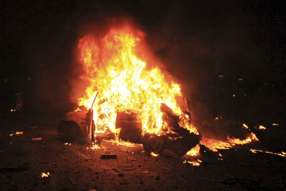 A vehicle burns after an explosion in Ankara