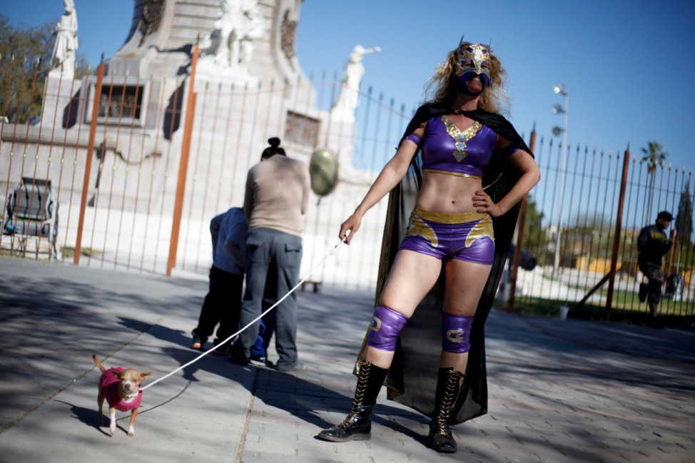 German wrestler and women's rights activist 'Diosa del Rhin' (Goddess of the Rhin) poses for a photograph with a Chihuahua dog during an event to create awareness about gender equality in Ciudad Juarez