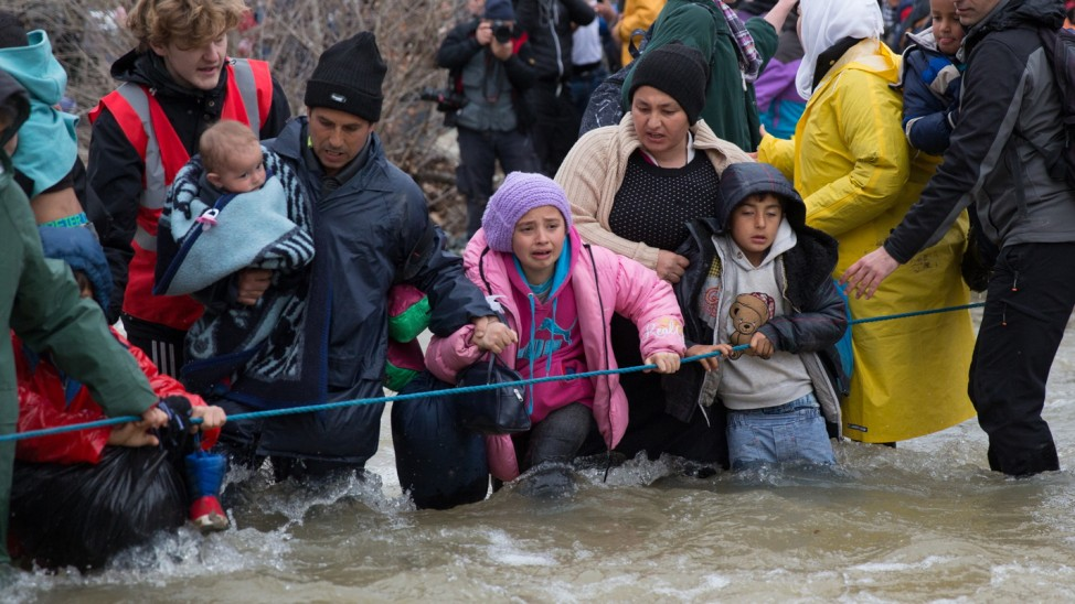 Frustrated Migrants Stranded On The Border Attempt To Walk In To Macedonia; GYI_515579758