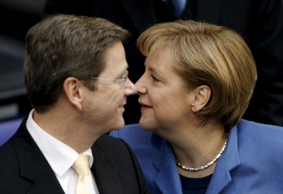 File picture shows German Chancellor Merkel and Foreign Minister Westerwelle arriving for Bundestag session in Berlin