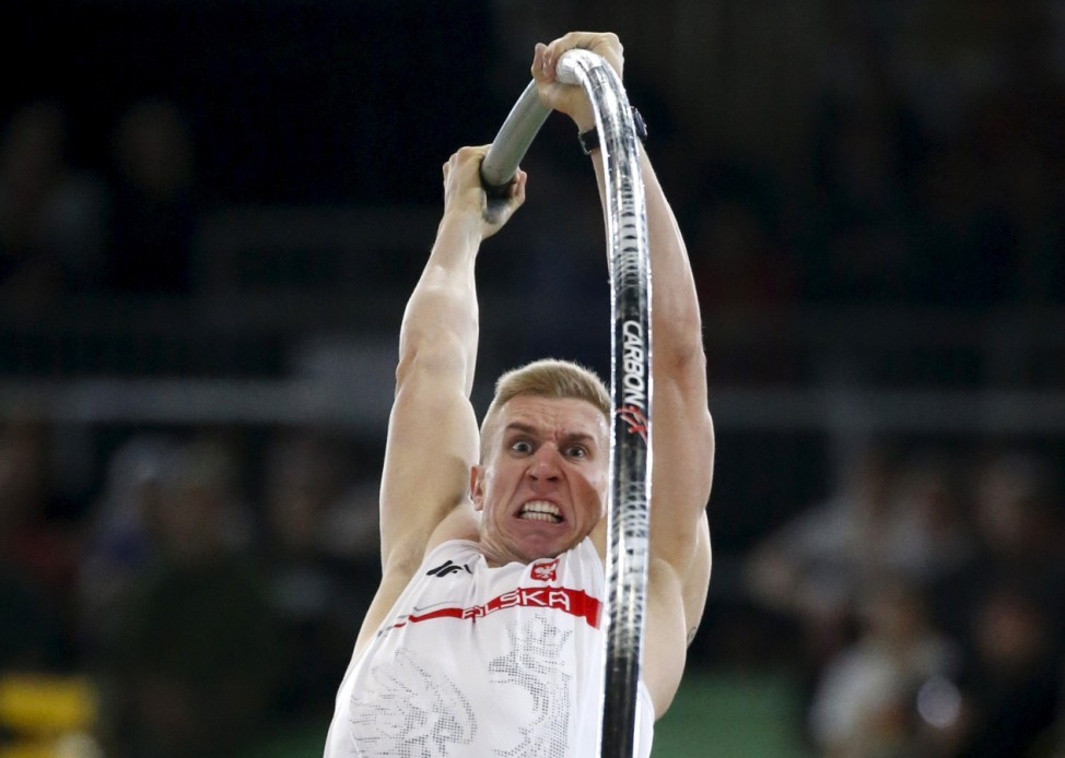 Lisek of Poland competes in the men's pole vault event during the IAAF World Indoor Athletics Championships in Portland