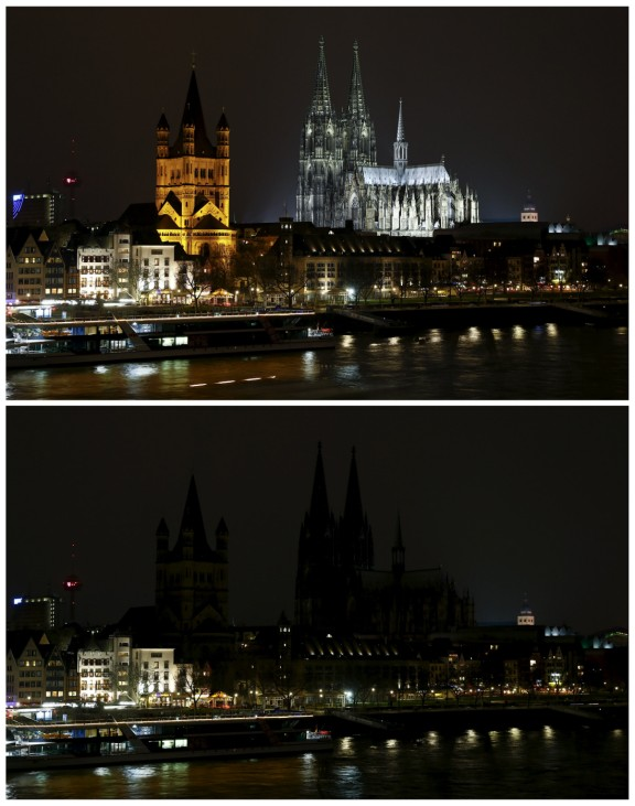 Combination photo shows the Cologne Cathedral, a UNESCO World Heritage site, before and during Earth Hour in Cologne