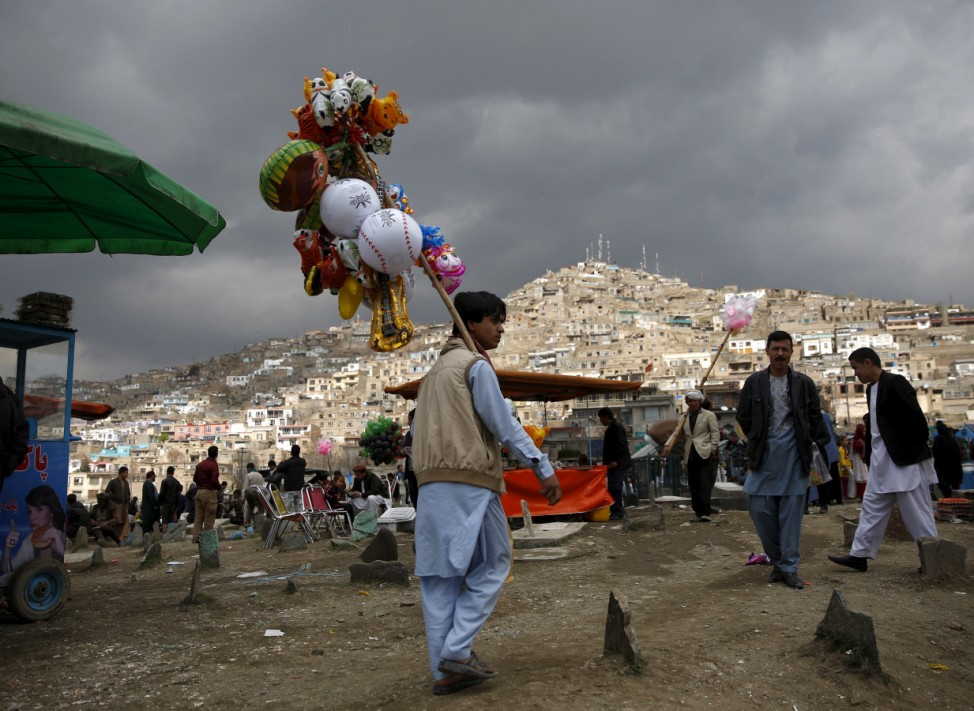 Afghan man sells toys during  the celebration for Afghan New Year (Newroz) in Kabul