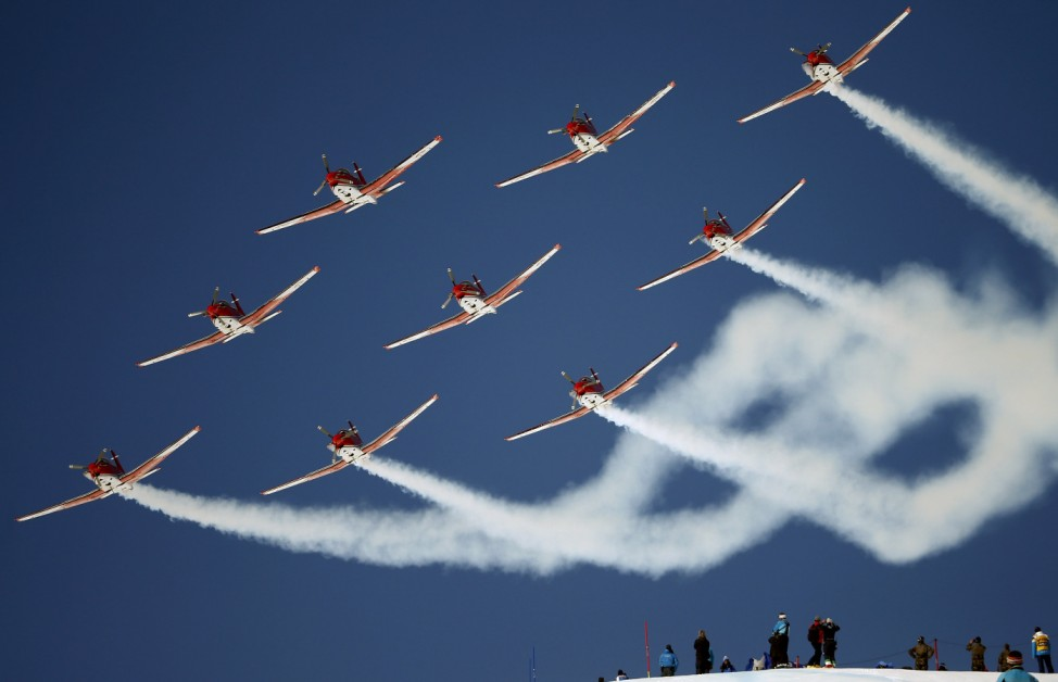 Members of the Swiss Air Force PC 7 team fly in formation over the Alpine Skiing World Cup finals in St. Moritz
