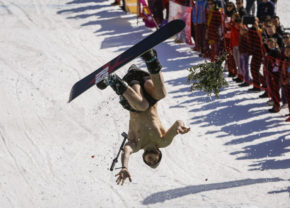 A snowboarder performs during the Red Bull Jump and Freeze contest at ski resort Shimbulak outside Almaty