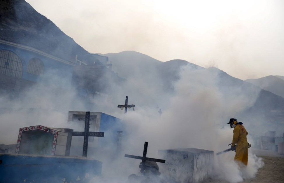 File photo of a health worker carrying out fumigation as part of preventive measures against the Zika virus and other mosquito-borne diseases at the cemetery of Carabayllo on the outskirts of Lima