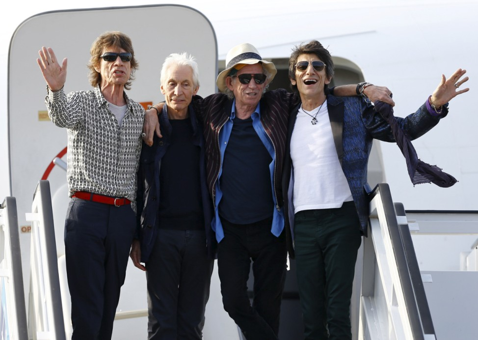 Mick Jagger, Charlie Watts, Keith Richards and Ronnie Wood of the Rolling Stones stand together after landing in Havana