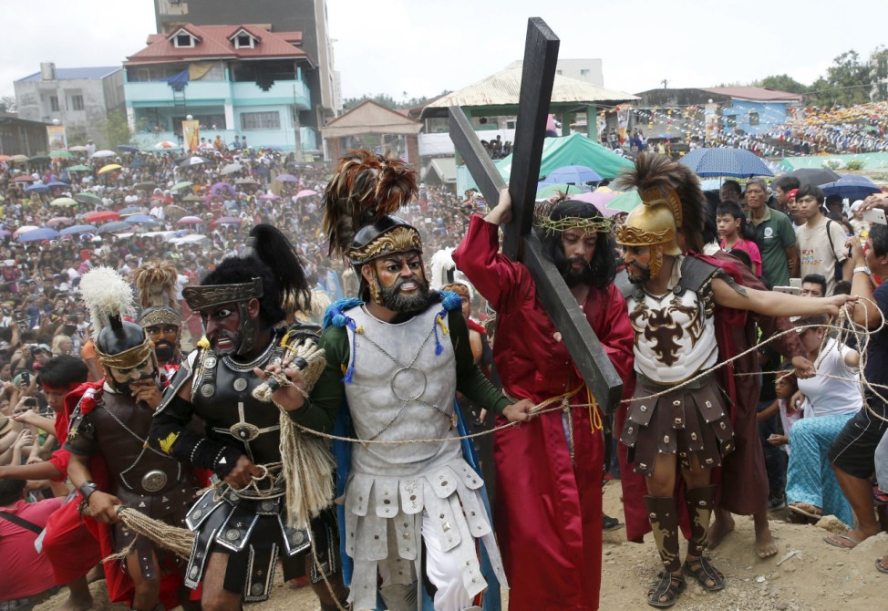 Morions wearing masks and centurion garbs take part during a Good Friday street play of the passion of Christ and crucifixion in Boac, Marinduque