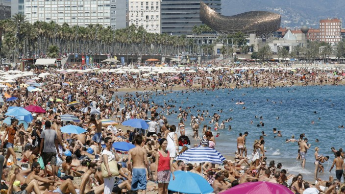 People cool off at Sant Sebastia and Sant Miquel beaches in Barceloneta neighborhood in Barcelona