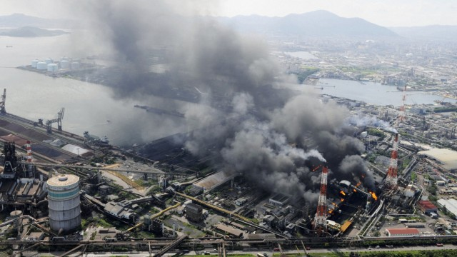 A fire burns at a Nippon Steel Corp plant in Kitakyushu