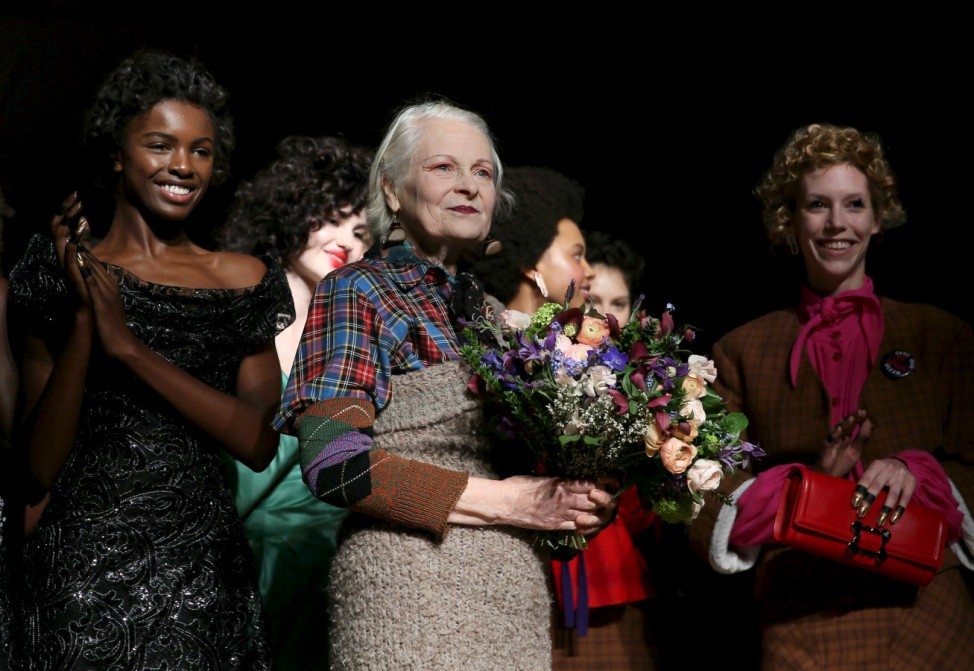 Designer Vivienne Westwood receives applause after her catwalk show at London Fashion Week Autumn/Winter 2016 in London, Britain
