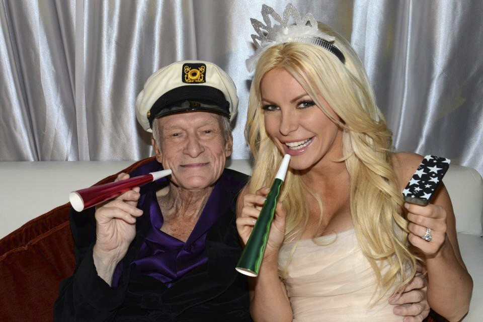 Octogenarian Playboy founder Hugh Hefner poses with his bride Crystal Harris as they ring in the new year at their wedding in Beverly Hills