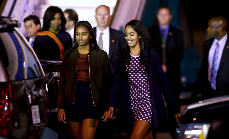 Daughters of U.S. President Barack Obama Sasha and Malia along First Lady Michelle Obama arrive at Buenos Aires' international airport