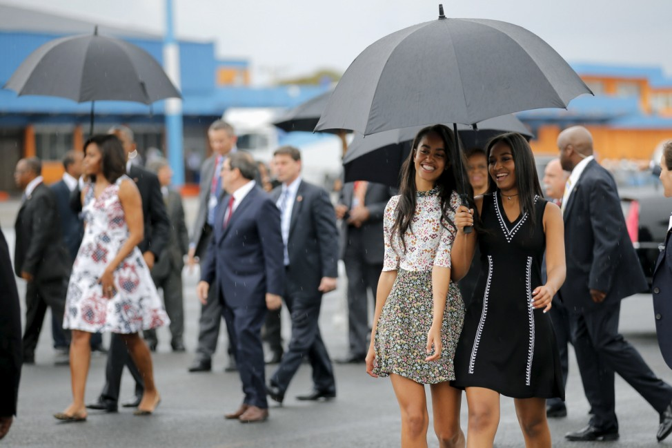 U.S. President Barack Obama's daughters Malia and Sasha arrive with their parents at the Jose Marti international airport at the start of a three-day visit to Cuba, in Havana